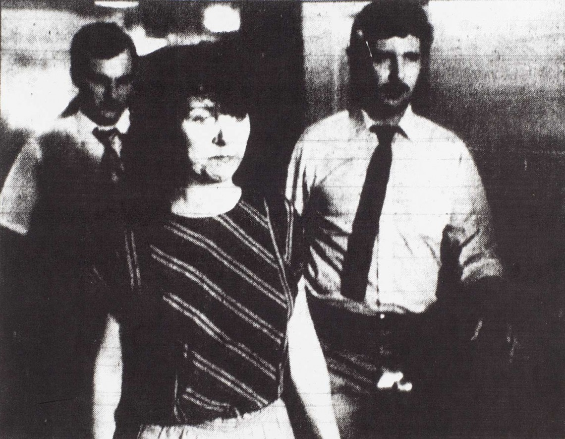 Detectives John Hutchinson (left) and Al Dawson escort Orsini to jail.
