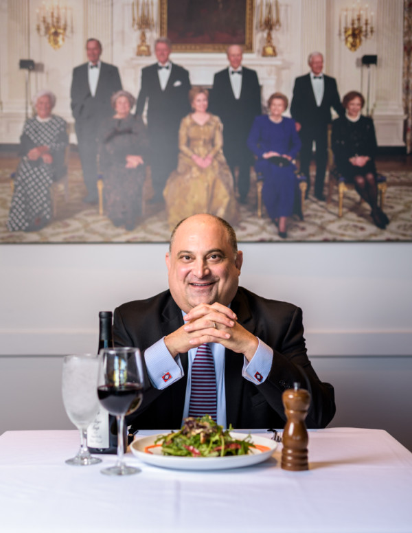 Under the watchful eyes of four former United States presidents and five first ladies, Michael Selig, Clinton Presidential Center director of food, beverage and events takes a dinner break in Cafe 42.