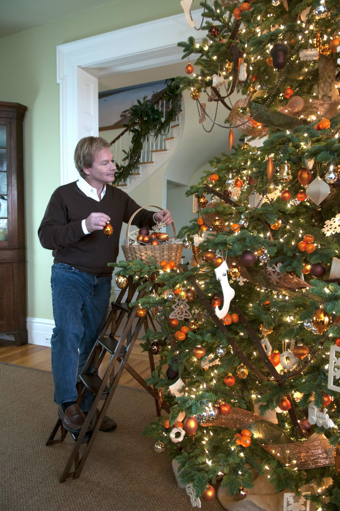 P. Allen puts finishing touches on his tree.