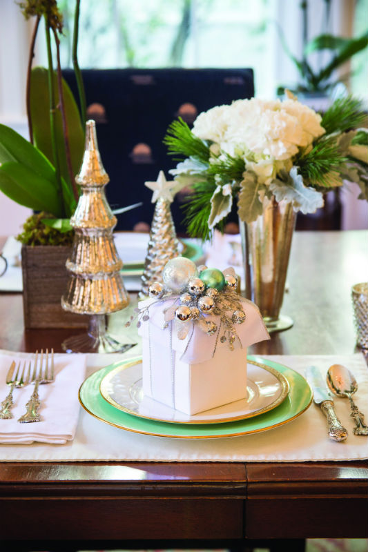 """'A Sophisticated Setting """"The rest of the house is decorated in a more laid-back fashion. So we decided to make the dining room more formal,"""" Bell said. """"We wanted to keep it simple yet festive, sophisticated but to still have it feel like Christmas."""""""