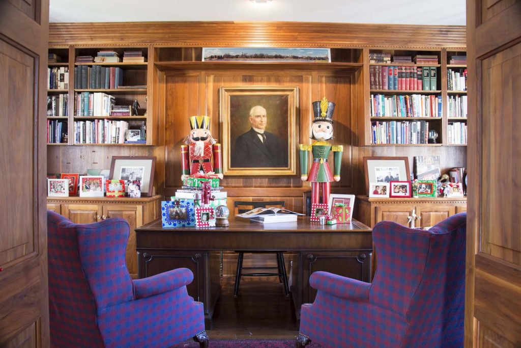 Wonder-filled Workspace Clarke Tucker's office is a comfortable and efficient space, with a burled walnut wall and great built-ins. The state representative's desk is a family heirloom that has been passed from generation to generation. A portrait of the late James P. Clarke, U.S. Senator and governor of Arkansas is proudly displayed in the background. During the holidays, Clarke uses the office as Santa's helper, making lists of who is naughty and nice. Bell made the space festive by adding traditional holiday decorations including these toy soldiers, as well as this Razorback nutcracker.