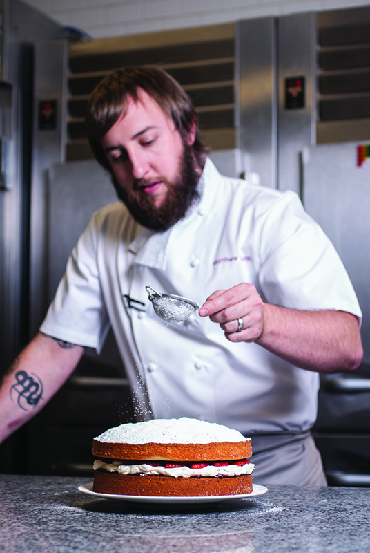 Pastry Chef matt Dunn sugar dusts a Victorian sponge cake, his mom's recipe. Dunn give his mom Christine and Nana Sylvia 100 percent credit as his culinary inspirations.