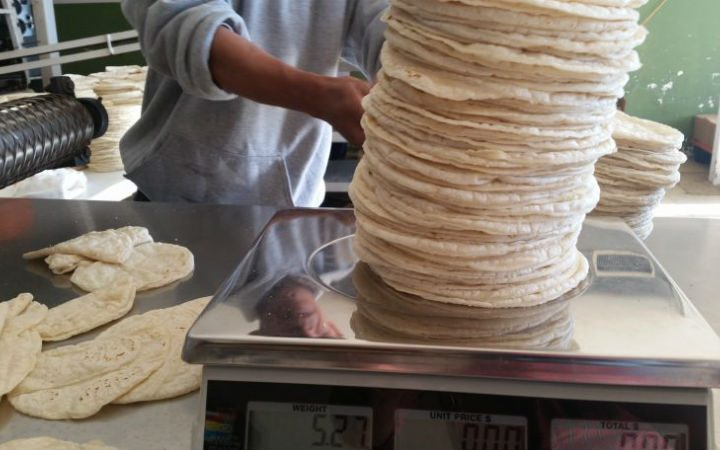 Tortillas big enough to cover your head or your bed ~ I never go home without 'em