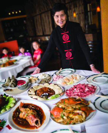 Lulu Chi, matriarch of the Chi restaurants, readies traditional delicacies for the Chinese New Year dinner celebrated with family.