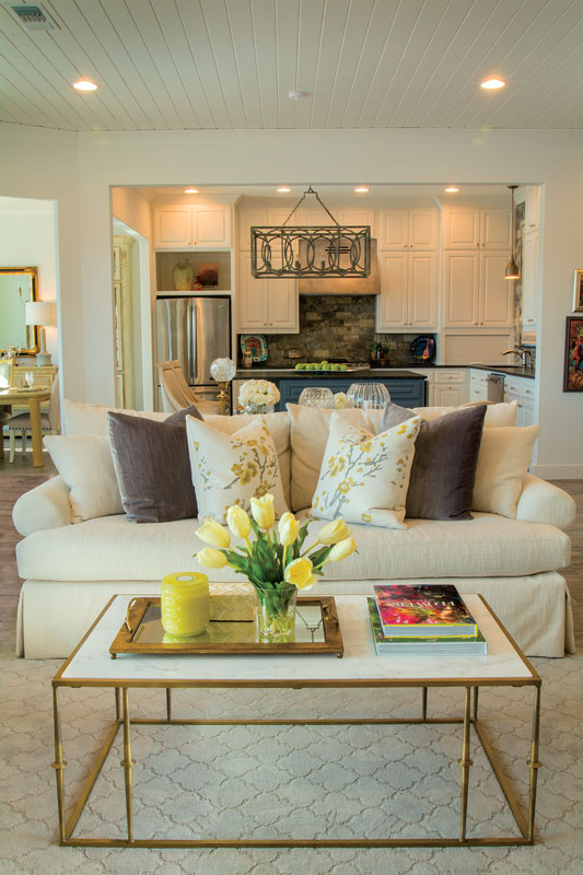 A custom coffee table by Providence Design and a sofa from Dillard's ground the living room in the home of Ashley and Brett Russell.