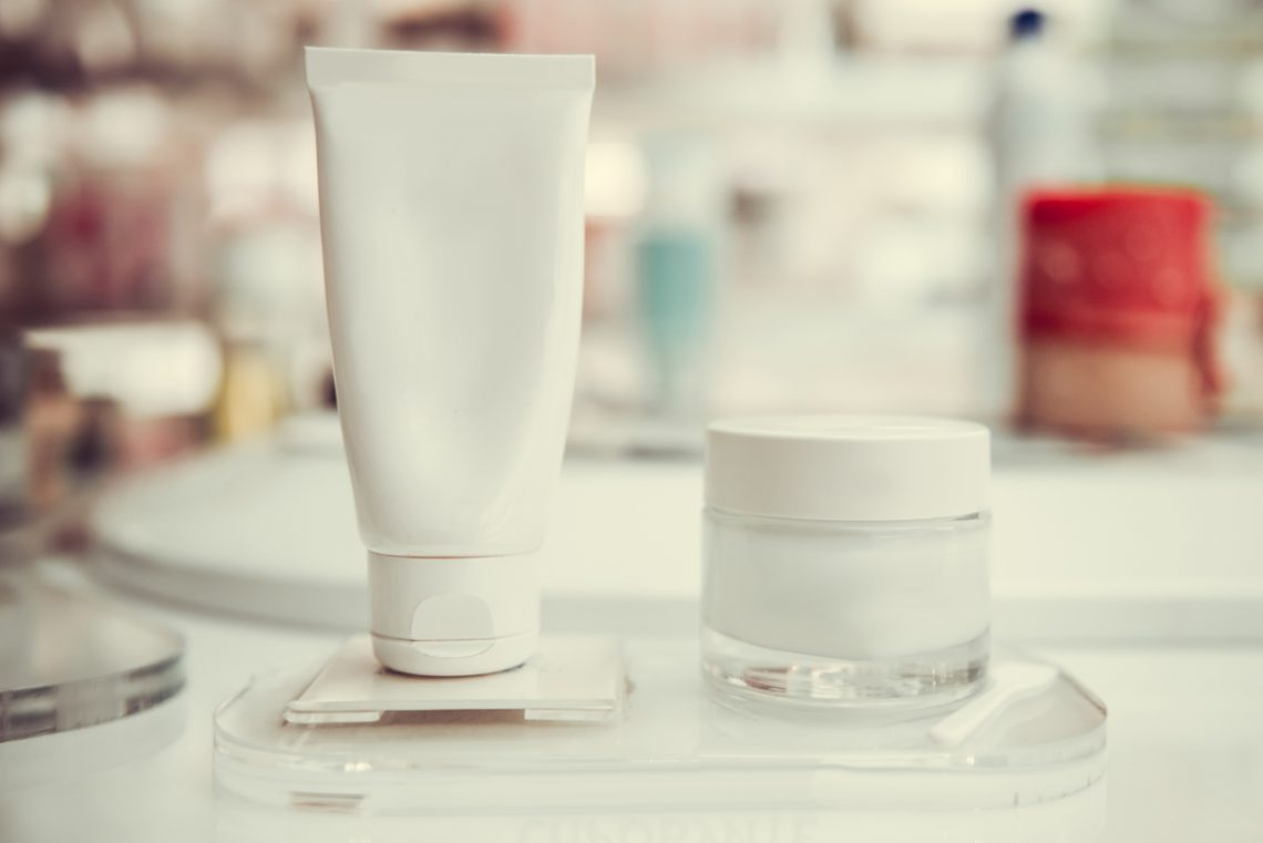Modern pharmacy products. Close-up of tube and jar with beauty treatment