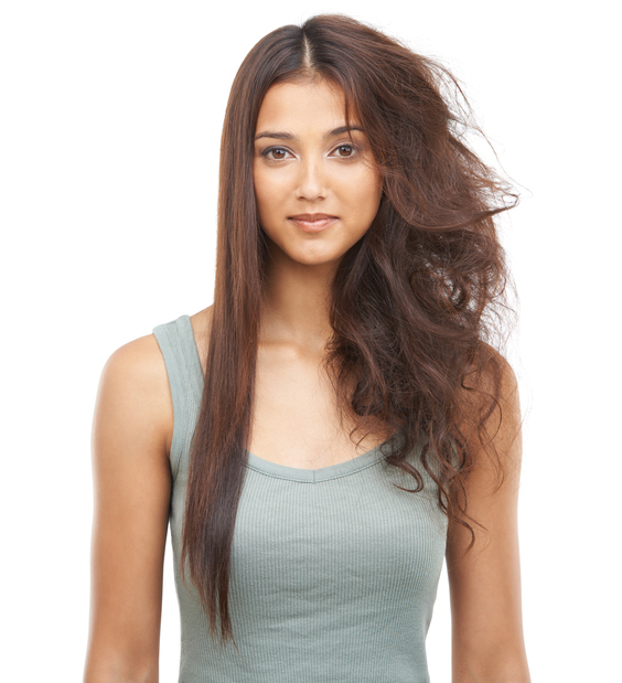 Portrait of a beautiful woman with one half of her hair straightened and the other messy