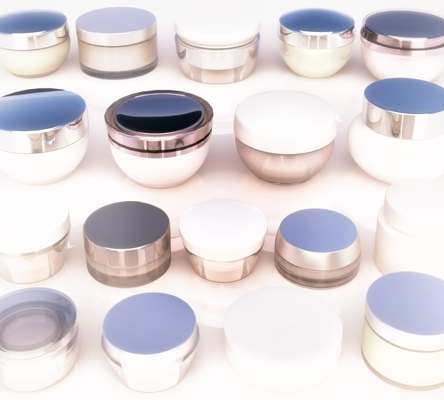 Lines of jars of daily beauty creams. The view from the top.