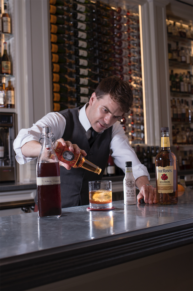 Loic Lautredou assembles the Cinnamon & Rosemary Old Fashioned.