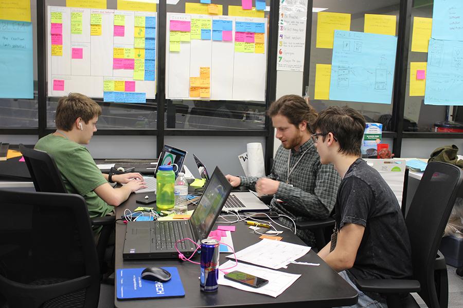 Young tech innovators work inside the Brewer Family Entrepreneurship Hub.