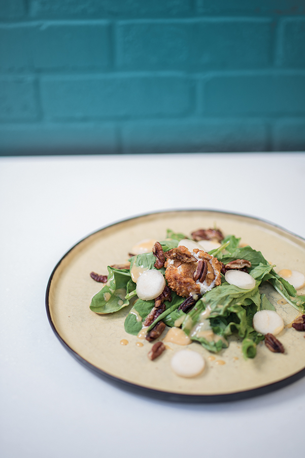 A fresh salad of greens, pecans and dressing from Table 28