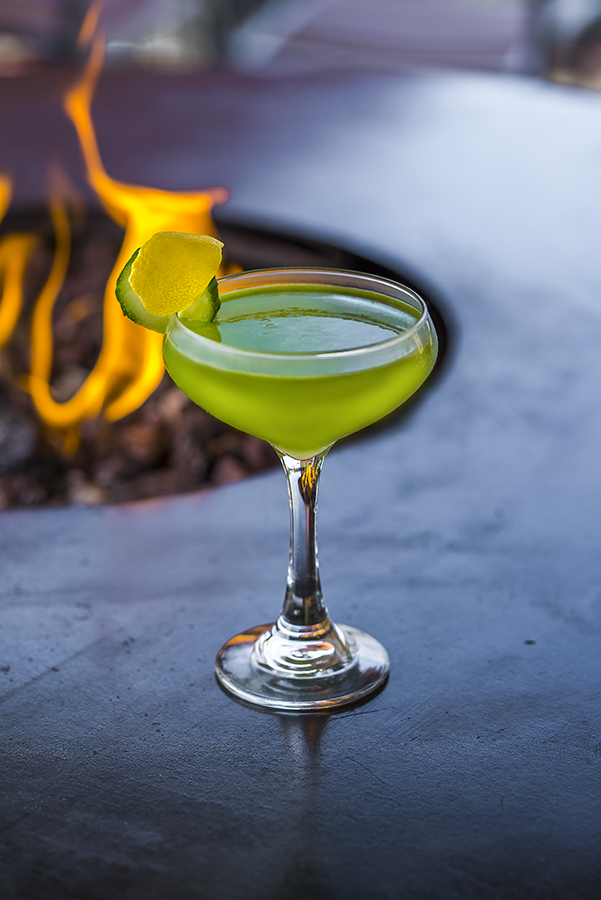 lime green drink with fire pit behind and lime