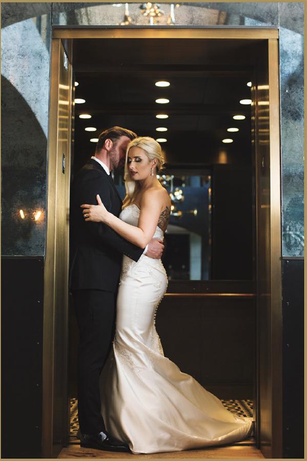 Ashley Murphy and her husband standing in doorway of elevator