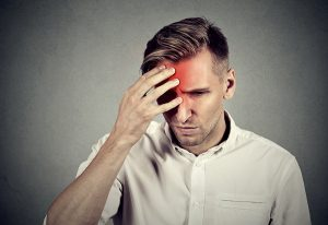 Stressed man with headache