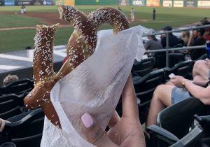 Pretzel in a hand at baseball park