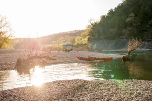 Canoes on Buffalo River with rocks and sky