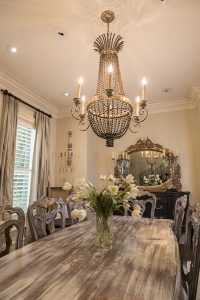 Dining table with light, chairs and window