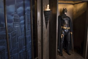 Batman inside of a themed room of a home