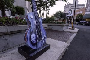 Guitar statue on sidewalk