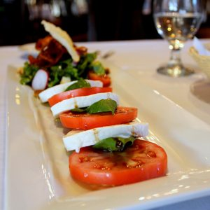 tomatoes and other food on a plate