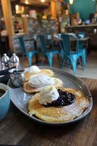 Pancakes with blueberry topping and whipped cream