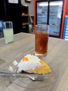 Pie on a plate with a drink