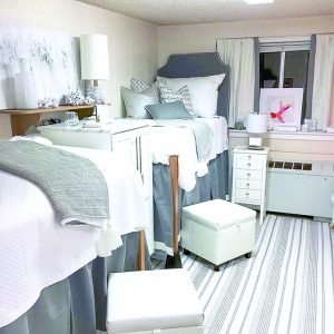 bright and cheerful dorm room with bed and windows