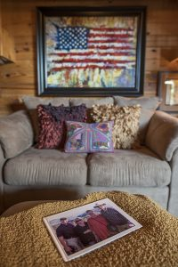 American flag artwork hanging in living room above couch