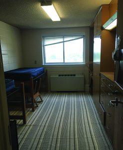 dark dorm room with window
