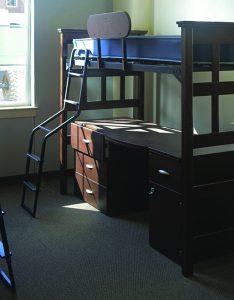dark dorm room with bunk bed and window