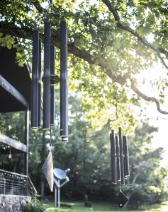 Wind chimes hanging in the trees