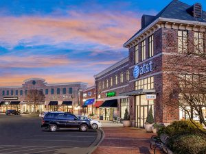 shopping center with buildings and cars